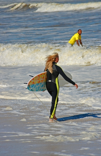 Female surfer at surfers corner