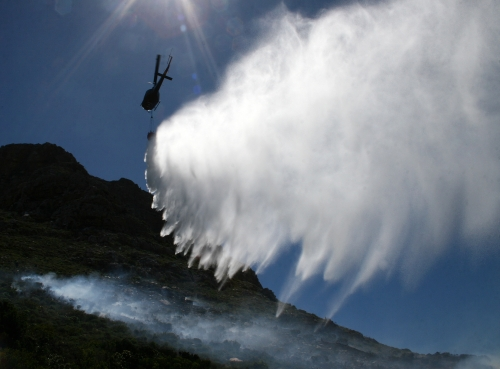 Fire chopper drops water onto the mountain