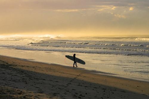 lady surfer surfers corner muizenberg